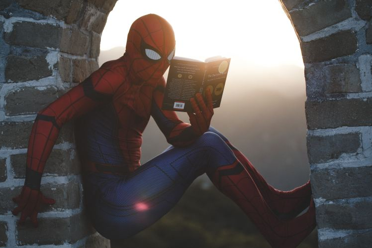 spiderman reading a book